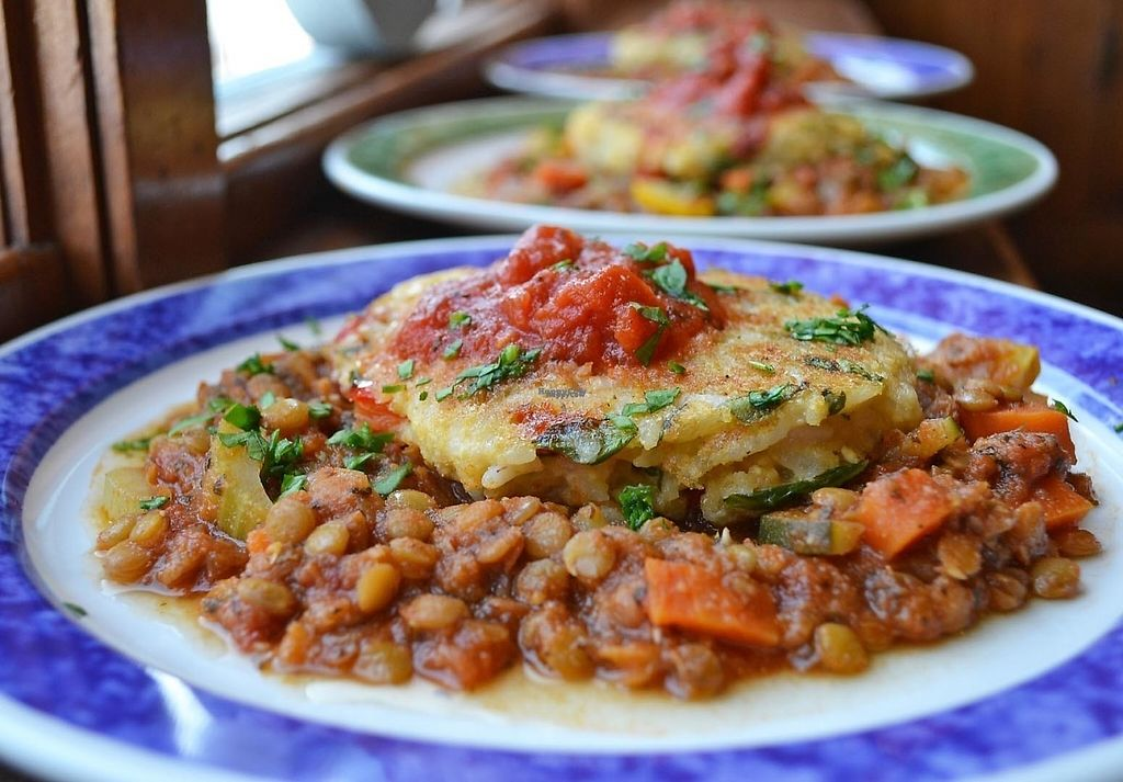 """Photo of Domus Fare  by <a href=""""/members/profile/American%20Vegan"""">American Vegan</a> <br/>risotto cake on lentil pilaf <br/> February 27, 2017  - <a href='/contact/abuse/image/56718/231016'>Report</a>"""