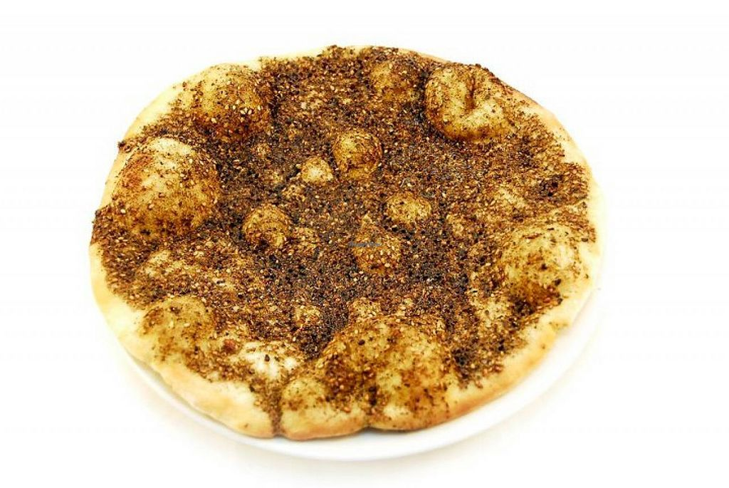 "Photo of Manoosh Pizzeria  by <a href=""/members/profile/community"">community</a> <br/>Zaatar pizza bread <br/> April 4, 2015  - <a href='/contact/abuse/image/56756/97767'>Report</a>"