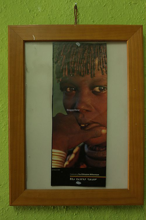 """Photo of Andu Caffe  by <a href=""""/members/profile/AnduCafe"""">AnduCafe</a> <br/>Andu Cafe's Interior design - picture of a person from one of Ethiopian tribes  <br/> June 28, 2017  - <a href='/contact/abuse/image/56847/274311'>Report</a>"""