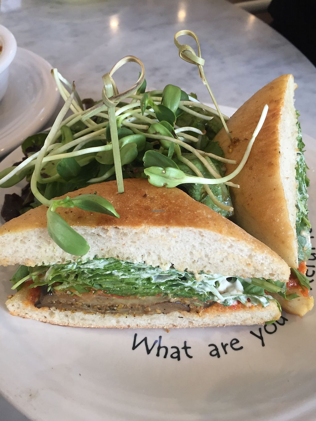 """Photo of Cafe Gratitude - DTLA  by <a href=""""/members/profile/R-MV"""" class=""""title__title"""">R-MV</a> <br/>I Am Awesome: Eggplant Parmesan Panini <br/> September 16, 2017  - <a href='/contact/abuse/image/57026/305154'>Report</a>"""