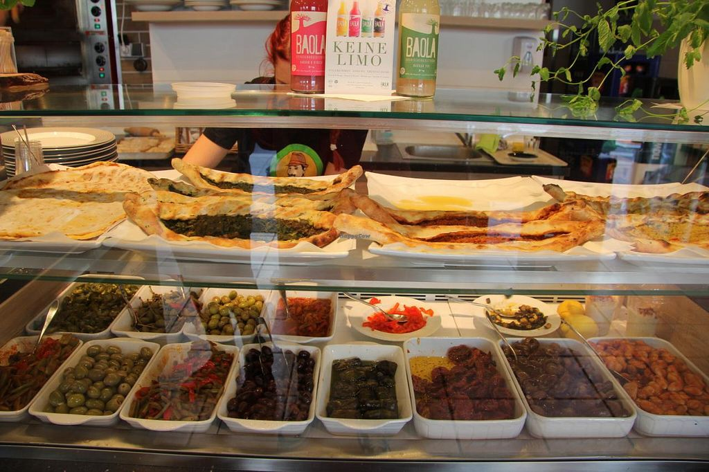 """Photo of Erbils Orient Lounge  by <a href=""""/members/profile/jschoder"""">jschoder</a> <br/>Food display showing vegan Lahmacun, Pide and assorted Antipasti <br/> June 30, 2015  - <a href='/contact/abuse/image/57037/107774'>Report</a>"""