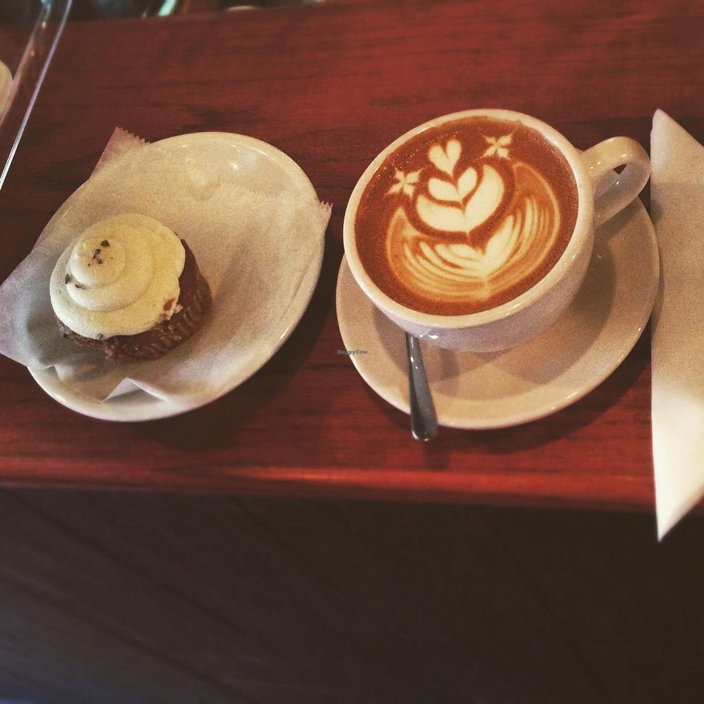 """Photo of Red Pipe Organic Cafe  by <a href=""""/members/profile/Babyshka"""">Babyshka</a> <br/>Vegan cupcake and flat white  <br/> April 3, 2015  - <a href='/contact/abuse/image/57108/97706'>Report</a>"""