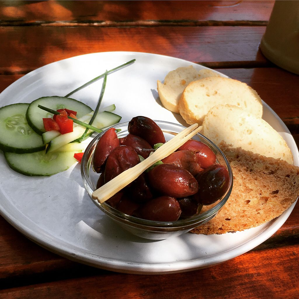 """Photo of Bioland Wirtshaus Konfetti  by <a href=""""/members/profile/vegancookie243"""">vegancookie243</a> <br/>to start we had some olives & fresh bread <br/> July 23, 2017  - <a href='/contact/abuse/image/57124/283922'>Report</a>"""