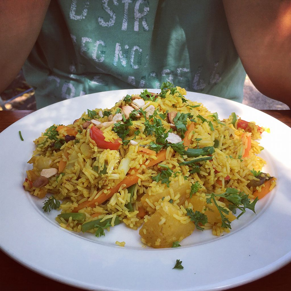 """Photo of Bioland Wirtshaus Konfetti  by <a href=""""/members/profile/vegancookie243"""">vegancookie243</a> <br/>the rice and curry dish with veggies and pineapple chunks  <br/> July 23, 2017  - <a href='/contact/abuse/image/57124/283924'>Report</a>"""