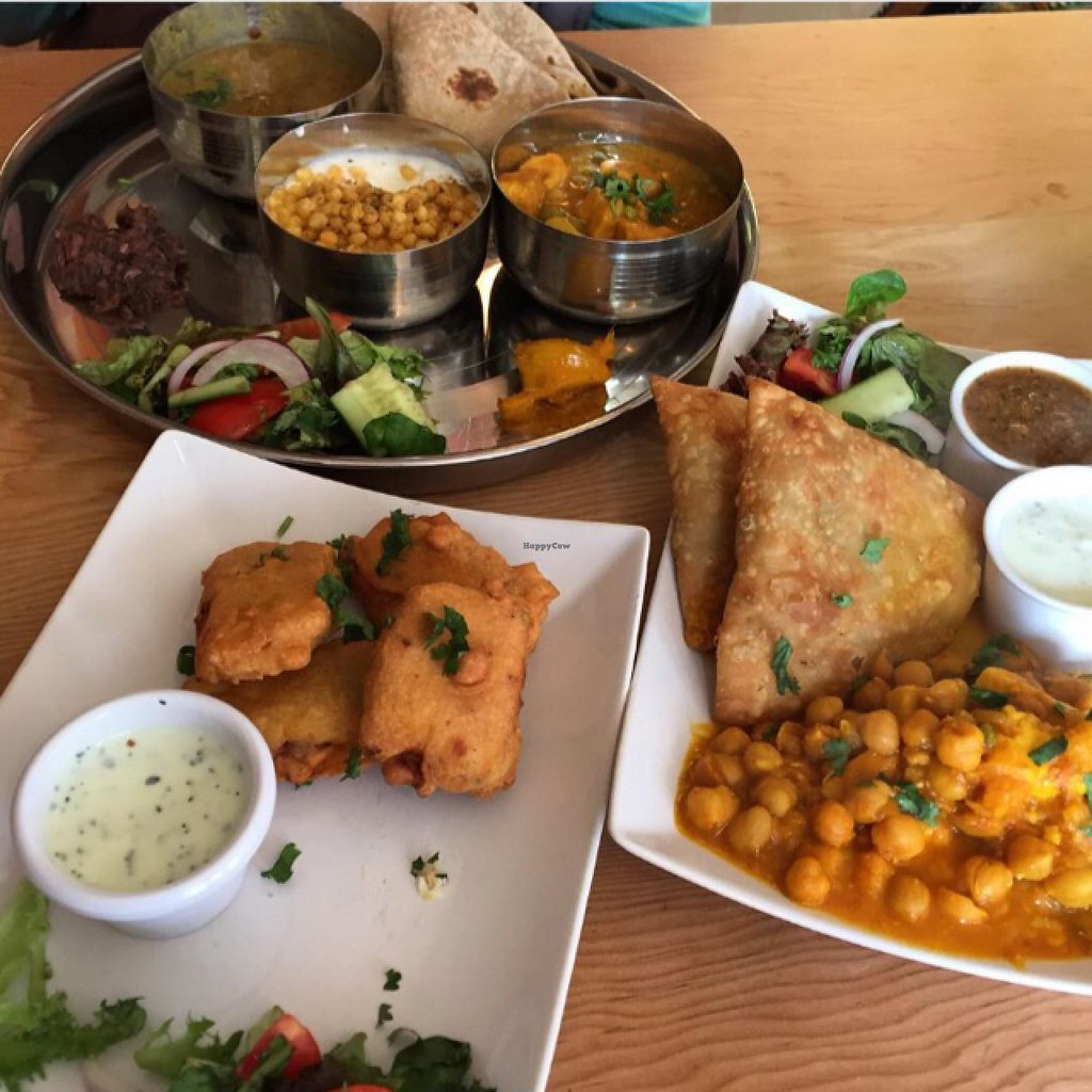 """Photo of Ranjit's Kitchen  by <a href=""""/members/profile/Ghiribizzo"""">Ghiribizzo</a> <br/>Oops! I already ate some paneer pakora...sorry about the empty space on the plate! <br/> August 10, 2015  - <a href='/contact/abuse/image/57422/113024'>Report</a>"""