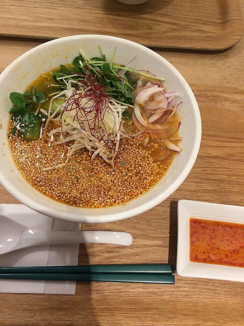 """Photo of T's Tan Tan  by <a href=""""/members/profile/TravelAmy"""">TravelAmy</a> <br/>white sesame ramen for around 880 yen  <br/> September 25, 2017  - <a href='/contact/abuse/image/57492/310975'>Report</a>"""
