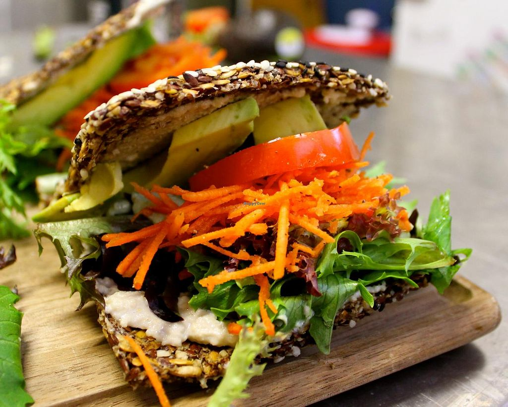 "Photo of Karanaki's Raw Food  by <a href=""/members/profile/SanderCummings"">SanderCummings</a> <br/>Raw Sandwich - dehydrated flax seed bread, basil cashew nut cheese, tomato, carrot, lettuce, avocado <br/> April 19, 2015  - <a href='/contact/abuse/image/57600/99659'>Report</a>"