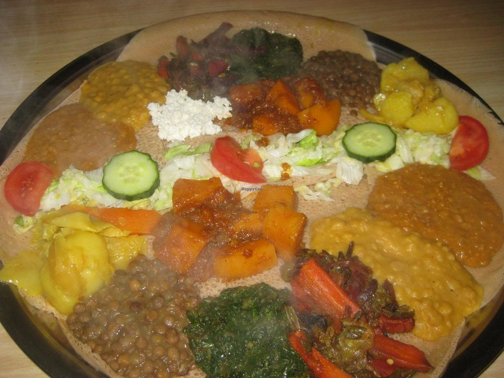 "Photo of Addis Ababa  by <a href=""/members/profile/jennyc32"">jennyc32</a> <br/>Combination plate (vegetarian on the far side, with the cottage cheese, vegan the near side - exactly the same but without the cottage cheese) <br/> April 19, 2015  - <a href='/contact/abuse/image/57607/99641'>Report</a>"