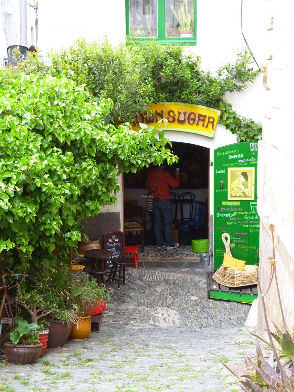 """Photo of Brown Sugar  by <a href=""""/members/profile/Arwenia"""">Arwenia</a> <br/>The lovely entrance of Brown Sugar Cafeteria in Cadaques <br/> April 30, 2015  - <a href='/contact/abuse/image/57856/100788'>Report</a>"""