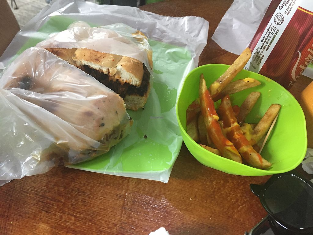 """Photo of Vegan Pa' Cá'  by <a href=""""/members/profile/SinzianaK"""">SinzianaK</a> <br/>Salchicha torta and cheesy fries  <br/> December 22, 2017  - <a href='/contact/abuse/image/57926/338214'>Report</a>"""