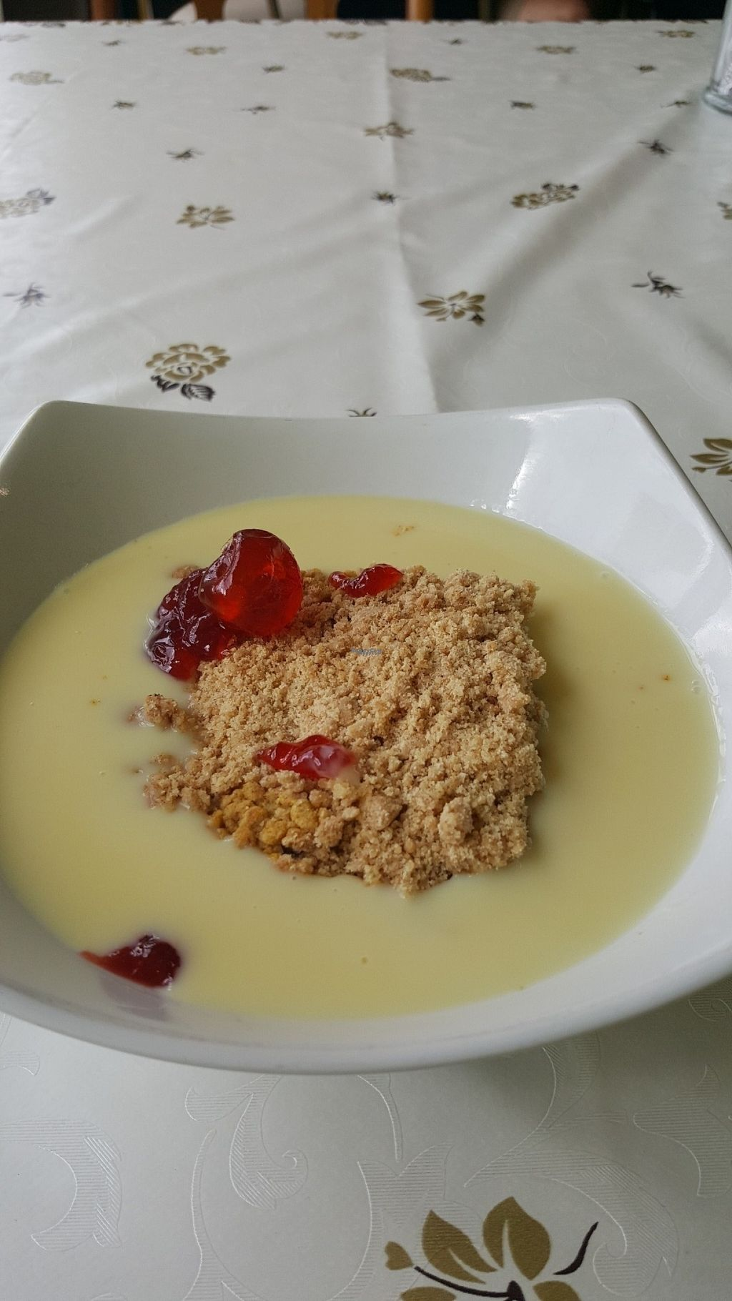 """Photo of CLOSED: LoveGift Vegan Cafe  by <a href=""""/members/profile/Clare"""">Clare</a> <br/>Pineapple crumble and custard <br/> August 10, 2016  - <a href='/contact/abuse/image/57965/167458'>Report</a>"""