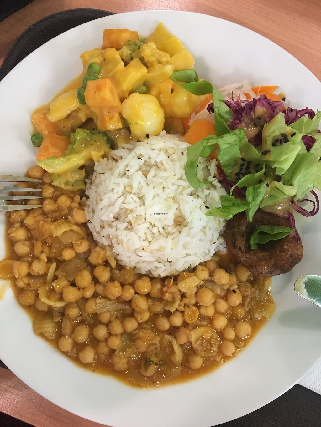 "Photo of Mennyorszag Szive  by <a href=""/members/profile/tcsengusz"">tcsengusz</a> <br/>Daily menu, rice, chickpea stew, bean patty, veggies in creamy pumpkin sauce, salad <br/> September 22, 2017  - <a href='/contact/abuse/image/58231/307065'>Report</a>"