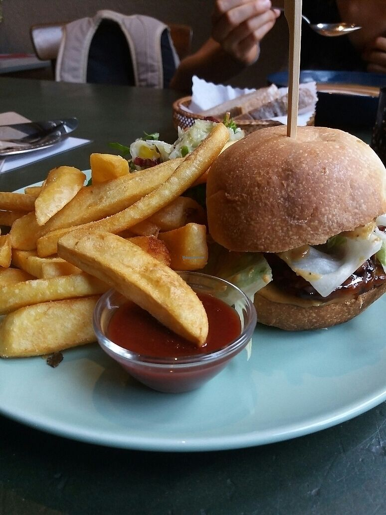 "Photo of Cafe Rost  by <a href=""/members/profile/Giniimaus"">Giniimaus</a> <br/>Orange tempeh burger with fries  <br/> October 6, 2017  - <a href='/contact/abuse/image/58538/312321'>Report</a>"