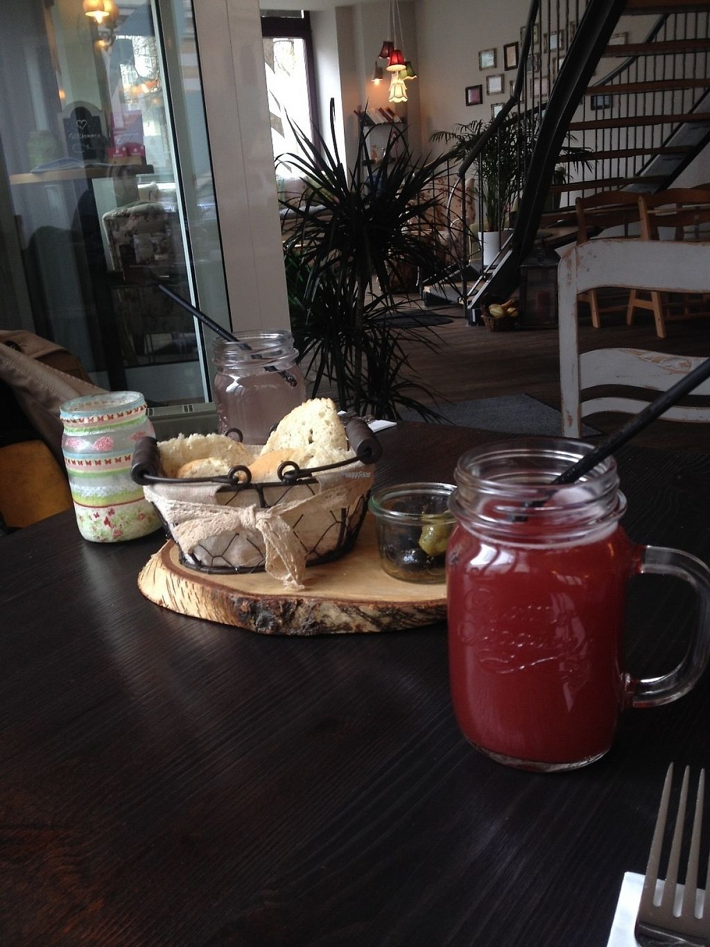 """Photo of GreenSoul  by <a href=""""/members/profile/o0Carolyn0o"""">o0Carolyn0o</a> <br/>Our drinks, a really tasty strawberry Schorle, and complimentary bread and olives <br/> November 21, 2016  - <a href='/contact/abuse/image/58779/192951'>Report</a>"""