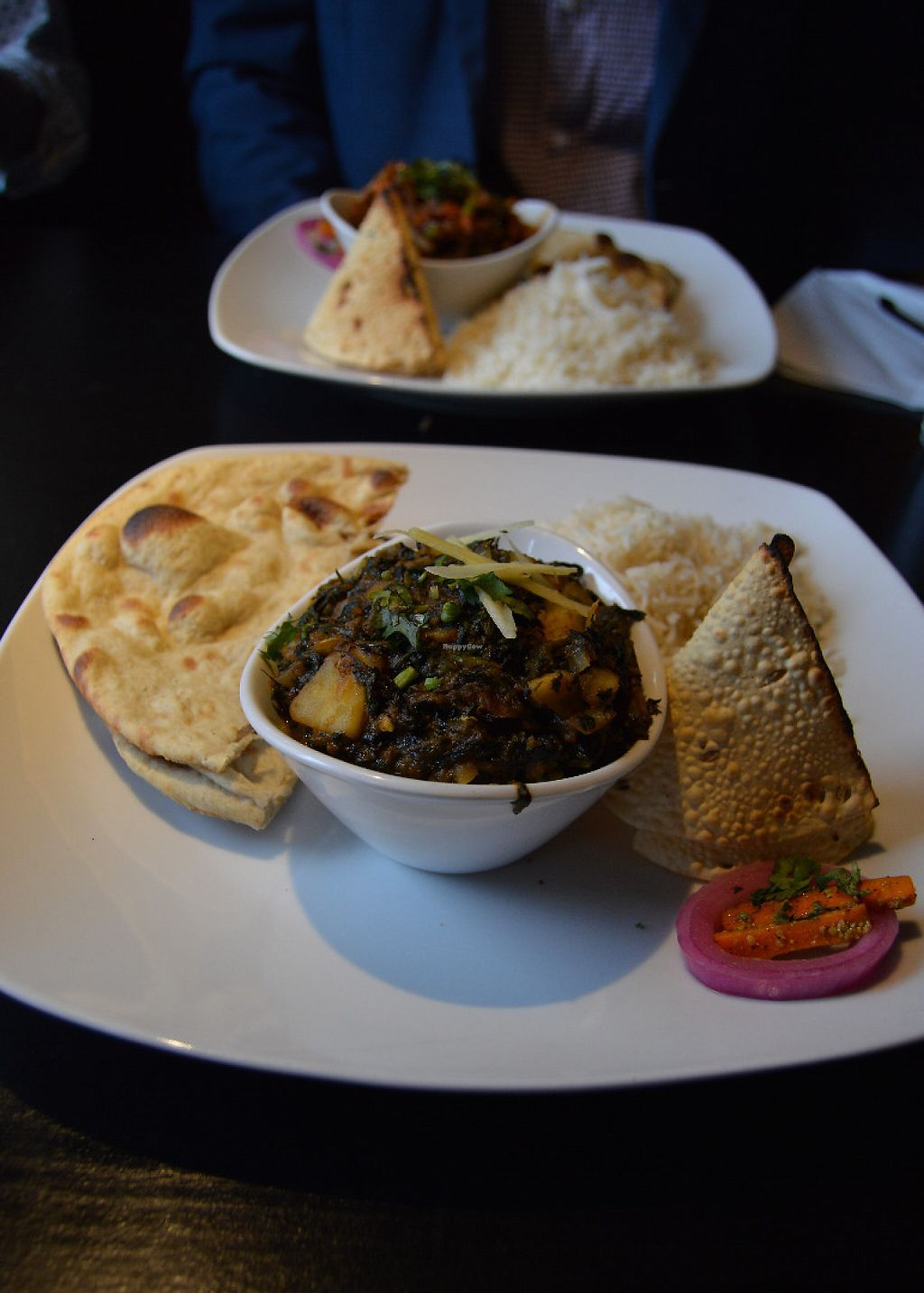 """Photo of Moksha Indian Bistro  by <a href=""""/members/profile/Vegan%20GiGi"""">Vegan GiGi</a> <br/>Methi aloo (fenugreek leaves and potato in nutty curry), and mixed vegetable jhal frazi (in the background). Both served with roti, rice, and a papadum cone. SO TASTY <br/> May 7, 2017  - <a href='/contact/abuse/image/58824/256454'>Report</a>"""