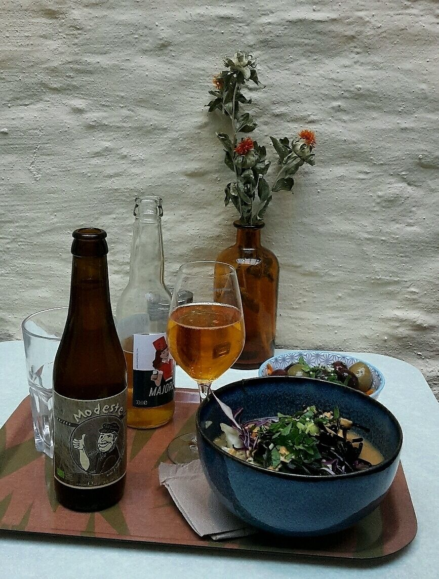 """Photo of Le Botaniste  by <a href=""""/members/profile/Espinaca"""">Espinaca</a> <br/>Bowl with noodles and kimchi, beer, cider, and Moroccan carrots with olives <br/> December 10, 2017  - <a href='/contact/abuse/image/59241/334259'>Report</a>"""
