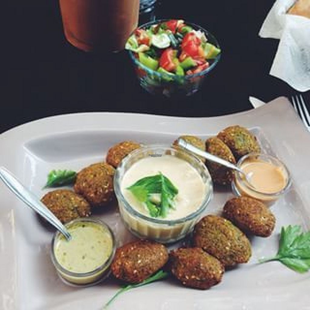 """Photo of Falafel Zone  by <a href=""""/members/profile/falafelzone"""">falafelzone</a> <br/>FALAFELZONE  Best home cooked delicacies falafel in falafelzone...open kitchen, the menu includes vegetarian, vegan, and raw options. Gluten-free bread ,vegan burger buns that is served at Falafelzone.Flavored with spices and herbs and usually served in pita or a wrap or dishes, the best are crispy on the outside and served so hot that steam rises from the soft center as you take your first bite.The ingredients are fresh and the falafels are flavored and cooked to crispy perfection.All spices are coming from Egypt ...  Falafel zone stands in the heart of Beyoğlu, just a stone's throw from istiklal street. The restaurant has quickly become a favorite among vegetarians and vegans, foreigners and locals alike. If you are looking for an on-the-go lunch and want something different from the fresh food and tasty dishes about falafel and vegetable rolls, Falafel zone is a perfect solution.As soon as you enter the Istiklal Street, you will start enjoying a little walk down,There are also tables outside the restaurant on a traffic barred street which is full of other cafes and restaurants.Whenever you are hungry or rewctant to cook at home, it is almosy possible to find the comfort of your home in Falafelzone.  TEL: 0212 251 13 23 http://falafelzone.blogspot.com e-mail:falafelzoneistanbul@gmail.com adres:FALAFELZONE istiklal caddesi öğüt sok no:4 Taksim-istanbul <br/> August 1, 2016  - <a href='/contact/abuse/image/59335/164199'>Report</a>"""