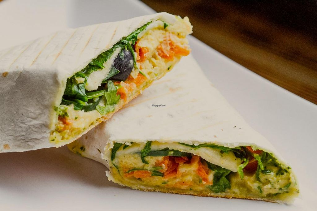 """Photo of The Goat Herder  by <a href=""""/members/profile/CorinneP"""">CorinneP</a> <br/>Hummus wrap (with grated carrot, black olives, cucumber, ruccola and pesto) <br/> June 25, 2015  - <a href='/contact/abuse/image/59338/107245'>Report</a>"""