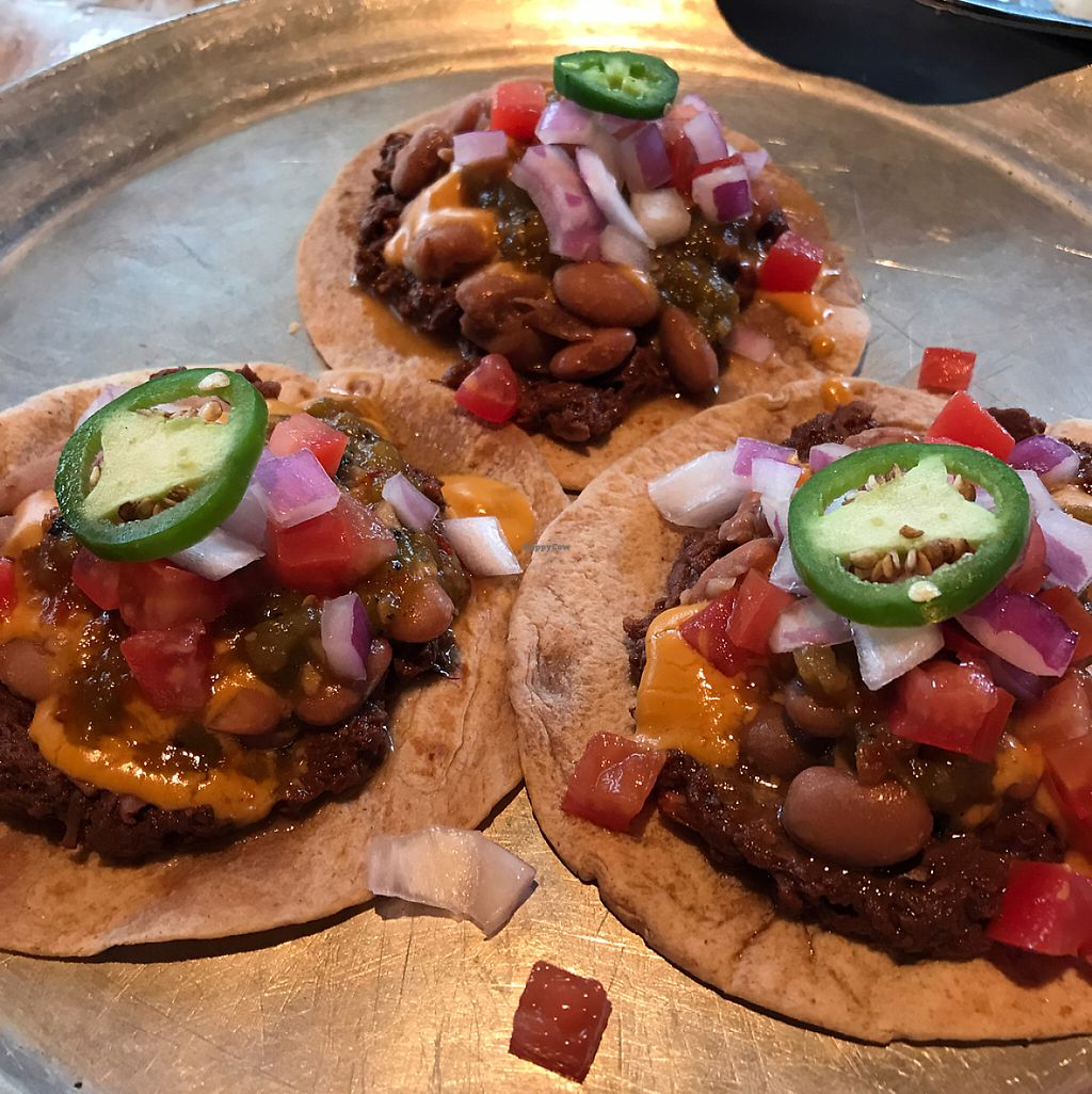 """Photo of The Burrowing Owl Lounge  by <a href=""""/members/profile/PatriciaCrosbie"""">PatriciaCrosbie</a> <br/>Erik Tostrado-  4 small tortillas topped with jackfruit, beans, green chili, onions, vegan cheese sauce, tomatoes and one jalapeño slice per <br/> May 28, 2017  - <a href='/contact/abuse/image/59373/263437'>Report</a>"""