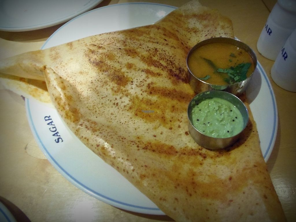 """Photo of Sagar  by <a href=""""/members/profile/CristinaRo"""">CristinaRo</a> <br/>Masala Dosa - Rice & lentil golden pancake filled with potato, onions & carrot, plus two types of sauces <br/> April 10, 2017  - <a href='/contact/abuse/image/5940/246807'>Report</a>"""