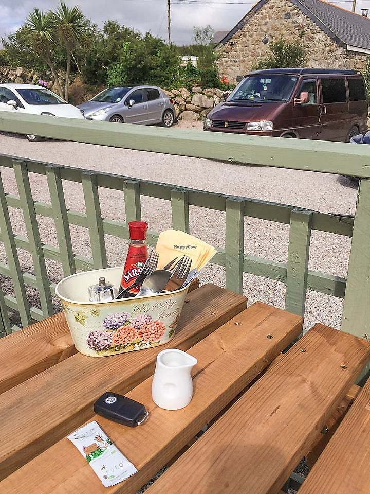 "Photo of Apple Tree Cafe  by <a href=""/members/profile/TheMiniMen"">TheMiniMen</a> <br/>Apple Tree Vegan Friendly Cafe outdoor Seating area (and my VDub Campervan) ??? <br/> July 16, 2017  - <a href='/contact/abuse/image/59431/280802'>Report</a>"