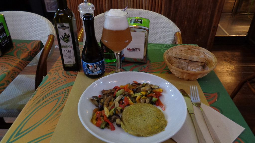 "Photo of V-Bar Natural  by <a href=""/members/profile/theexternvoid"">theexternvoid</a> <br/>A burger with a quinoa base and several veggies mixed in (corn, broccoli, carrots, etc.) with sauteed veggies on the side, and an organic saison beer <br/> September 22, 2017  - <a href='/contact/abuse/image/59607/307234'>Report</a>"