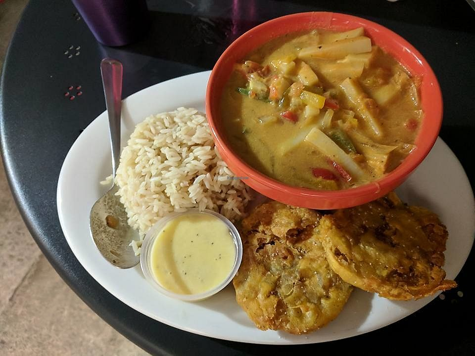 """Photo of Equelecua Cuban Cafe  by <a href=""""/members/profile/zenmaestro"""">zenmaestro</a> <br/>Palmitos en Coco(Gluten Free & Soy Free) - Hearts of palms, onions and bell peppers in coconut milk, served with white rice & tostones <br/> November 10, 2017  - <a href='/contact/abuse/image/59617/323835'>Report</a>"""