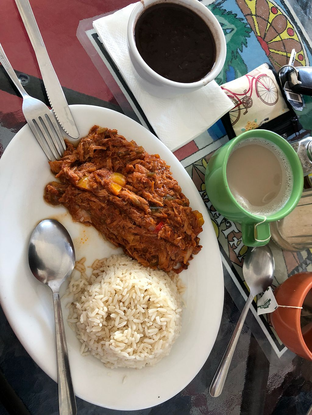 """Photo of Equelecua Cuban Cafe  by <a href=""""/members/profile/xoines"""">xoines</a> <br/>I think this one was shredded beef and it was served with rice and beans. I absolutely loved it! It was really flavorful and a bit sweet because of the yellow bell peppers. I'm a good eater but the plate will make you full haha. Also pictured in the green cup is a tropical tea latte with pineapple flavor. Trust me you HAVE to try it! I ordered it with almond milk. No sweetener added. I'm obsessed with this drink now!! <br/> February 6, 2018  - <a href='/contact/abuse/image/59617/355825'>Report</a>"""