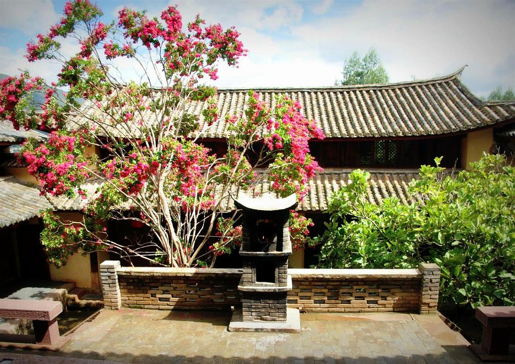 "Photo of Pear Blossom  by <a href=""/members/profile/ShaxiPizza"">ShaxiPizza</a> <br/>Pear Blossom Shaxi restaurant is tucked into a quiet courtyard of the Pear Orchard Temple - a functioning nunnery for nearly 500 years in Shaxi Yunnan China. Vegetarian friendly cuisine and international wine selection <br/> June 30, 2015  - <a href='/contact/abuse/image/60003/107735'>Report</a>"