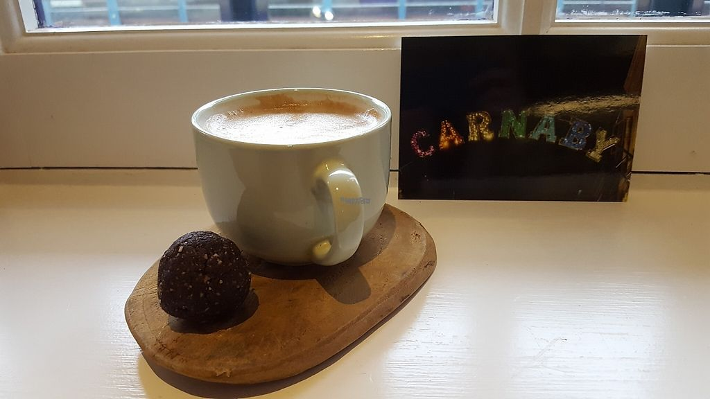 """Photo of So Pure  by <a href=""""/members/profile/VeganAnnaS"""">VeganAnnaS</a> <br/>Hazelnut milk latte and frerro (hazelnut) ball <br/> April 28, 2017  - <a href='/contact/abuse/image/60036/253443'>Report</a>"""