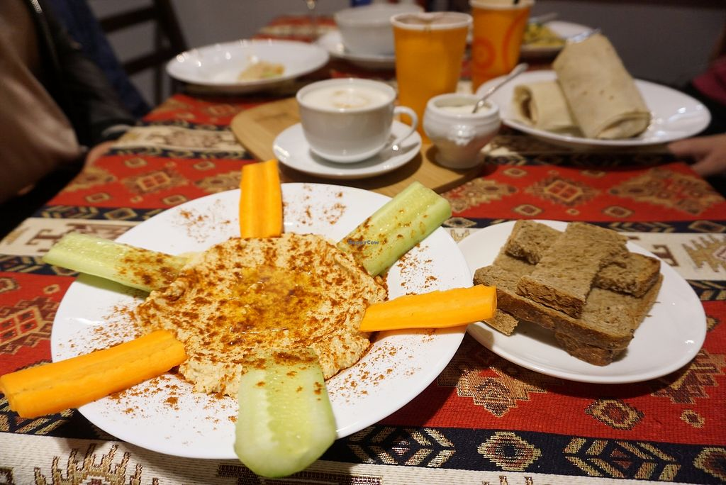 """Photo of Kiwi Vegan Cafe  by <a href=""""/members/profile/stadthund"""">stadthund</a> <br/>Hummus with bread, soy vanilla latte (the one and only in town!), famous wrap on the background <br/> October 19, 2017  - <a href='/contact/abuse/image/60107/316731'>Report</a>"""