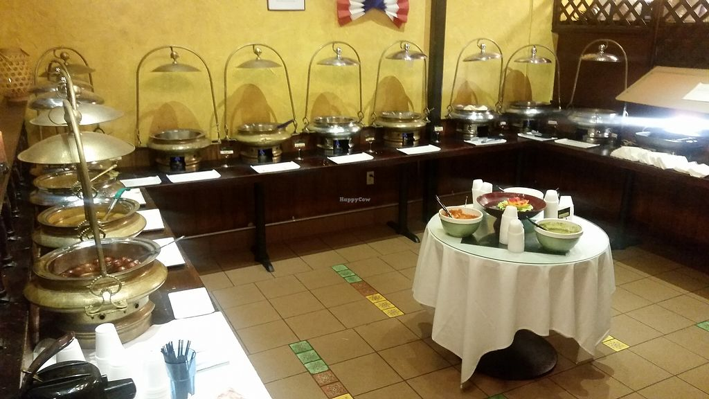 """Photo of Malgudi Garden  by <a href=""""/members/profile/WhatDoYouEatThen"""">WhatDoYouEatThen</a> <br/>Malgudi Garden While in Texas for the Gun Rights Policy Conference 2017, I stopped by this Indian Restaurant & Buffet for dinner in east Dallas. It is GREAT !!  More pics here http://whatdoyoueatthen.com/malgudi-garden-plano-tx/  Vegetarian Buffet at Malgudi Garden in Plano, Texas  The buffet was great. Pizza (with an indian flavor) many types of rice & other pasta / breads, then 5 or 6 types of main dishes, salads, fruit, etc too  The flavors were out of this world, this is the way i like to eat new foods, at a buffet where I can sample all and learn what I like best  Cant go wrong in a vegetarian restaurant though, it will all be good  I didnt find this one on the@HappyCowGuideapp, but it is on their website, so ill post a review and more pics  #TexasVegetarianRestaurant #VegetarianFood <br/> December 18, 2017  - <a href='/contact/abuse/image/60220/336711'>Report</a>"""