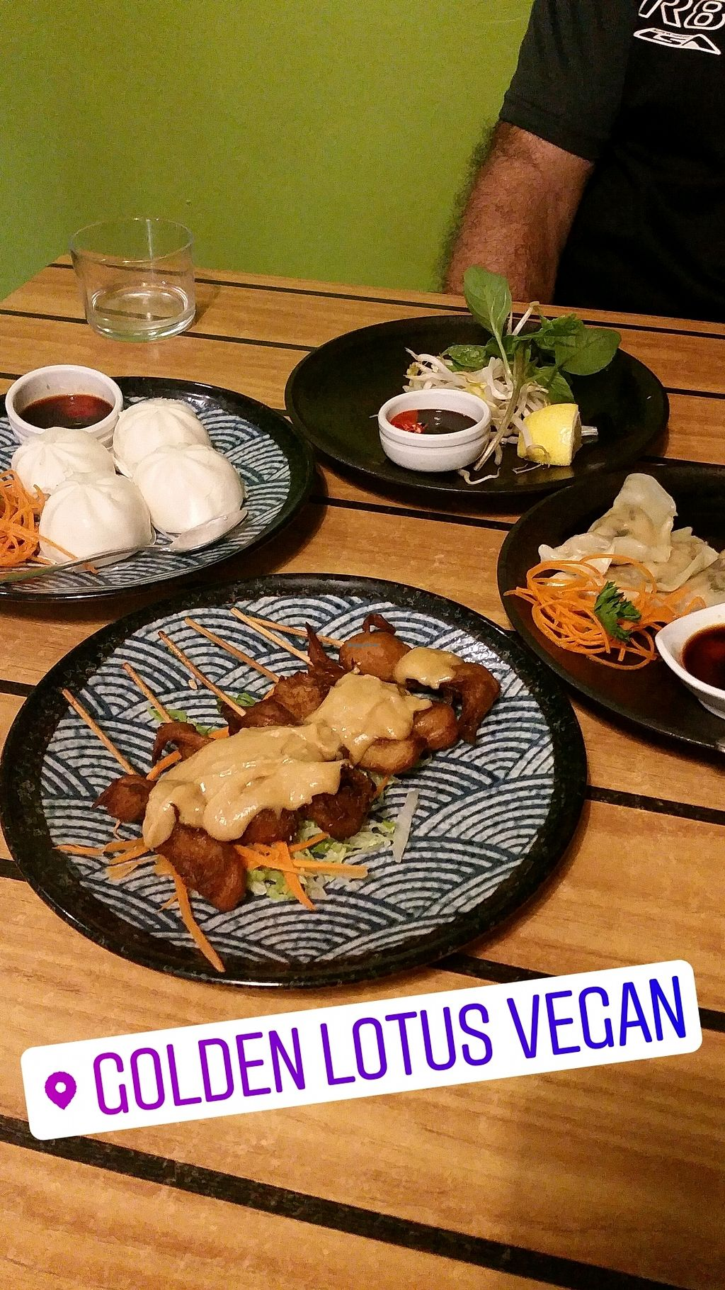 """Photo of Golden Lotus Vegan  by <a href=""""/members/profile/JulianaMurace"""">JulianaMurace</a> <br/>entrees - satay sticks, steamed buns and dumplings <br/> August 26, 2017  - <a href='/contact/abuse/image/60395/297331'>Report</a>"""