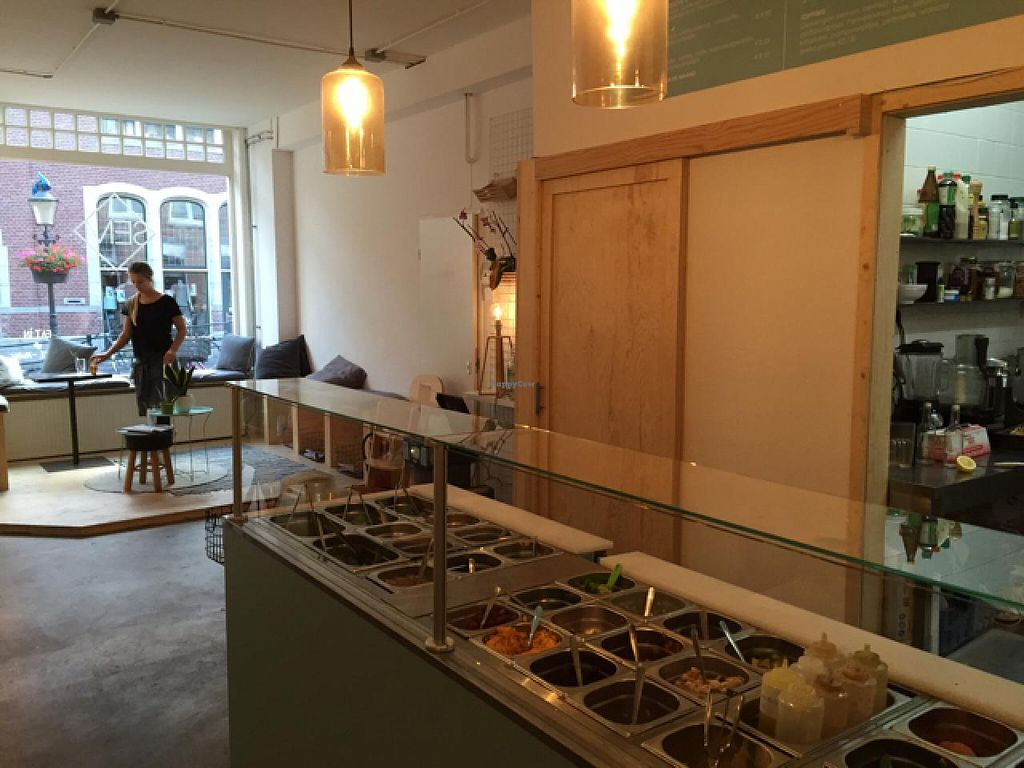 """Photo of SEM Sla En Meer  by <a href=""""/members/profile/Welmoed"""">Welmoed</a> <br/>Salad bar and cosy seating near the window <br/> July 9, 2015  - <a href='/contact/abuse/image/60425/108713'>Report</a>"""