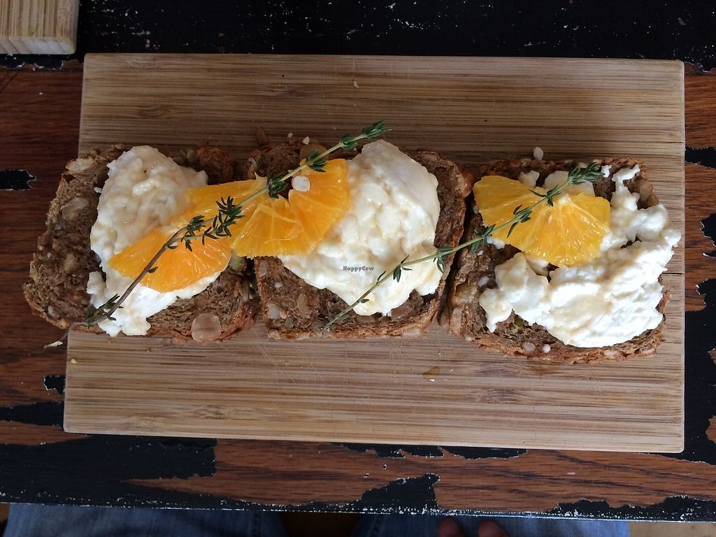 """Photo of SEM Sla En Meer  by <a href=""""/members/profile/Mawu"""">Mawu</a> <br/>Homebaked bread with goat cheese, a slice of orange and thyme <br/> August 1, 2017  - <a href='/contact/abuse/image/60425/287753'>Report</a>"""