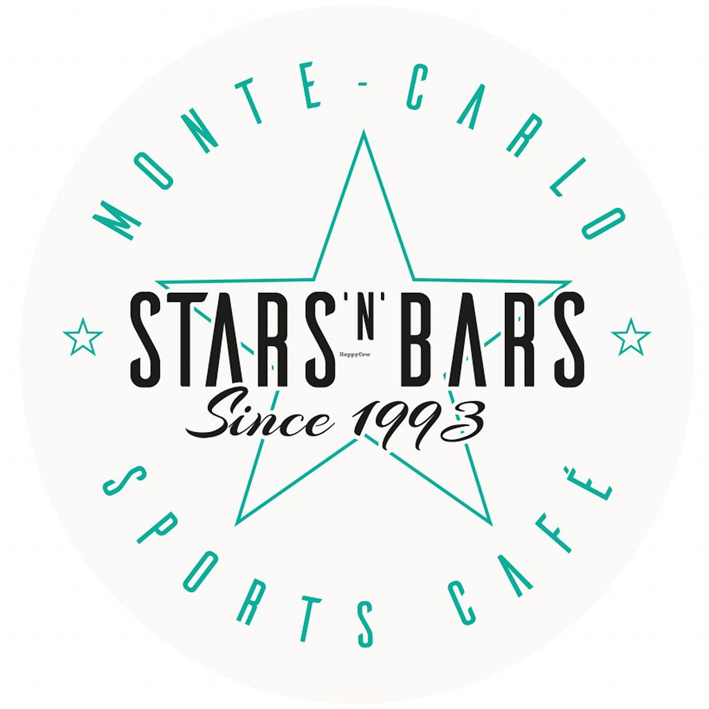 """Photo of Stars n Bars  by <a href=""""/members/profile/Ecohub"""">Ecohub</a> <br/>STARS'N'BARS was created 24 years ago by Kate Powers and Didier Rubiolo, who saw a need for a family-oriented restaurant in a principality famous for its casinos, Formula 1 races and luxury yachts. They recognized that Monaco, despite its """"jet set"""" reputation was also a normal, ordinary community with working mothers and fathers and their children who wanted interesting, reasonably priced and quality dining outside the home. Originally an old, abandoned warehouse before opening its doors in 1993, STARS'N'BARS is now a three story entertainment complex ideally located on the port of Monaco, offering full professional restaurant and catering services with breathtaking views of the harbour and skyline, easy access and parking.  STARS'N'BARS offers the best steaks, burgers and American-style service in the principality as well as a diverse choice of other international cuisines including Mexican, Indian and Asian. We also offer a selection of freshly-made vegetarian, vegan and non-gluten choices.  Many of our authentically homemade dishes and ingredients are organic, including our ground beef and French fries, and we depend on fresh, high quality products, that are sourced locally wherever possible and delivered daily.  A favorite among international sports stars and fans alike, the restaurant features one of the largest celebrity sports collections in the world, including an actual F1 racing car donated by two-time world champion Mika Hakkinen, Each May, the restaurant's terrace serves as the Grand Prix """"paddocks"""" where the greatest Formula 1 drivers in the world and their teams set up headquarters during the four day Monaco racing event.  Plus there's jerseys from Magic Johnson and Michael Jordan, footballs and uniforms signed by Cantona, Pele and SuperBowl legends as well as rackets, balls and photos given by Nadal, Federer and McEnroe. Monaco is also a favorite destination of international f"""