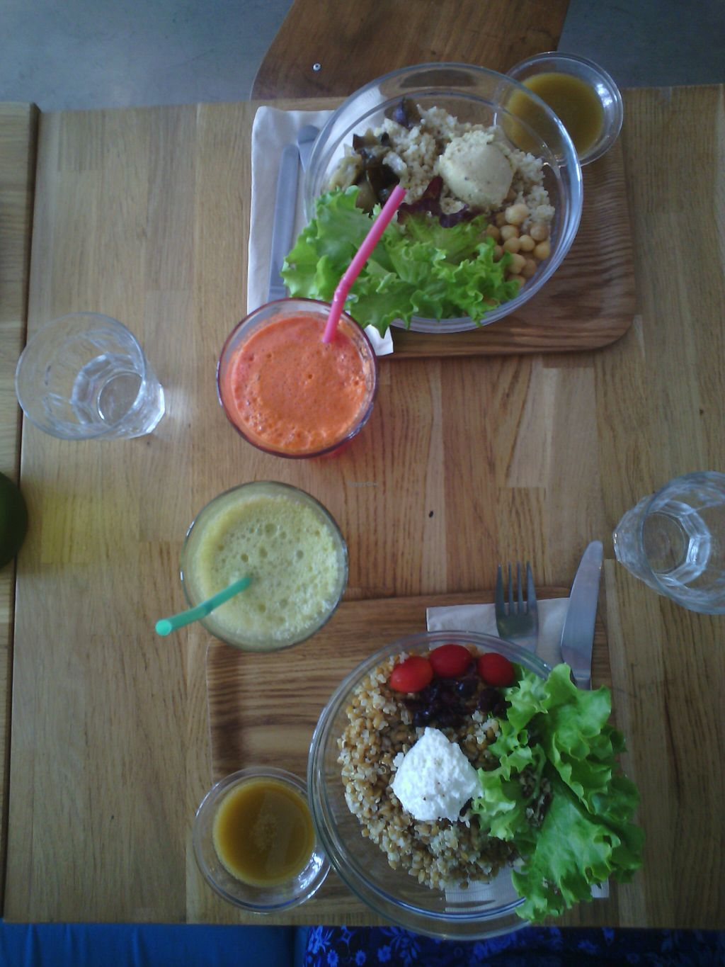 "Photo of ÖST café  by <a href=""/members/profile/hbanlin"">hbanlin</a> <br/>Andine salad (quinoa+goat cheese+ dried grapes) and Beyrouth salad (boulghour+zucchini hummous+chickpeas+roasted eggplant) with both green and energy juice <br/> August 14, 2015  - <a href='/contact/abuse/image/60710/113545'>Report</a>"