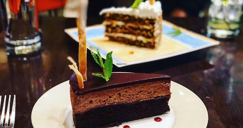 "Photo of Herban Fix Vegan Kitchen  by <a href=""/members/profile/Dancingpurplemermaid"">Dancingpurplemermaid</a> <br/>Carrot cake and Chocolate cake <br/> April 19, 2018  - <a href='/contact/abuse/image/60802/388278'>Report</a>"
