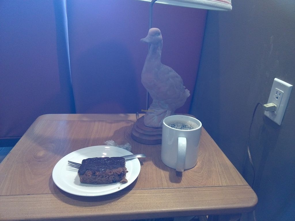 "Photo of CLOSED: Heaven on Earth Cafe  by <a href=""/members/profile/Ryecatcher"">Ryecatcher</a> <br/>Vegan carrot cake with coffee and duckish table lamp <br/> September 21, 2015  - <a href='/contact/abuse/image/60870/118687'>Report</a>"