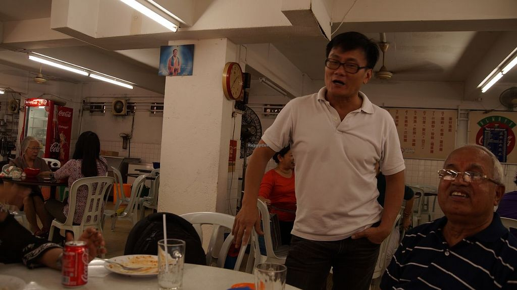 """Photo of Blue Boy Vegetarian Food Centre Stall  by <a href=""""/members/profile/nbhat"""">nbhat</a> <br/>Mr Chung giving suggestion on food <br/> October 11, 2015  - <a href='/contact/abuse/image/6111/121053'>Report</a>"""