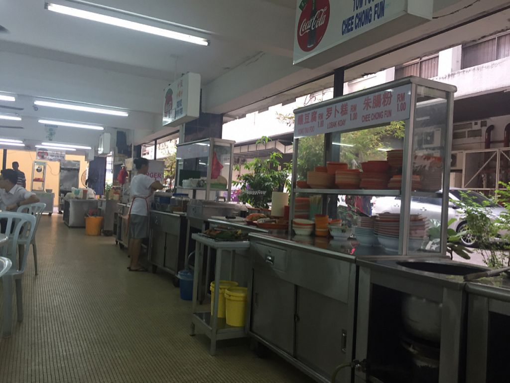 """Photo of Blue Boy Vegetarian Food Centre Stall  by <a href=""""/members/profile/jozborn"""">jozborn</a> <br/>the helpful waitress plating up our food <br/> January 18, 2017  - <a href='/contact/abuse/image/6111/212997'>Report</a>"""