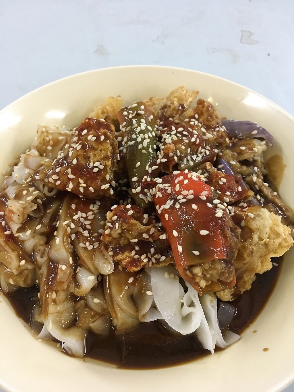 """Photo of Blue Boy Vegetarian Food Centre Stall  by <a href=""""/members/profile/pauldub"""">pauldub</a> <br/>Chee cheong fun (flat rice noodles with sesame hoisin sauce, fried tofu skin, stuffed chilli and eggplant) <br/> March 22, 2018  - <a href='/contact/abuse/image/6111/374452'>Report</a>"""