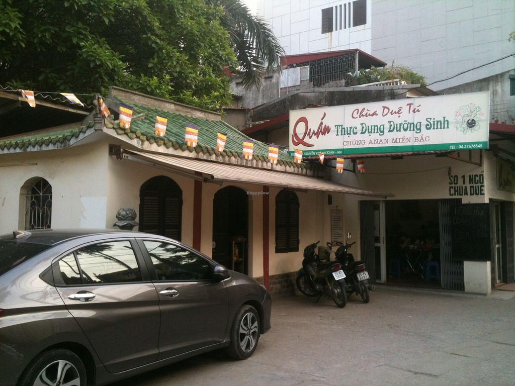"""Photo of CLOSED: Cua Hang Thuc Pham An Chay Tot  by <a href=""""/members/profile/heloisepe"""">heloisepe</a> <br/>View of the restaurant from outside. The pagoda is on the left and there is another pagoda building on the right <br/> July 27, 2015  - <a href='/contact/abuse/image/61189/111255'>Report</a>"""