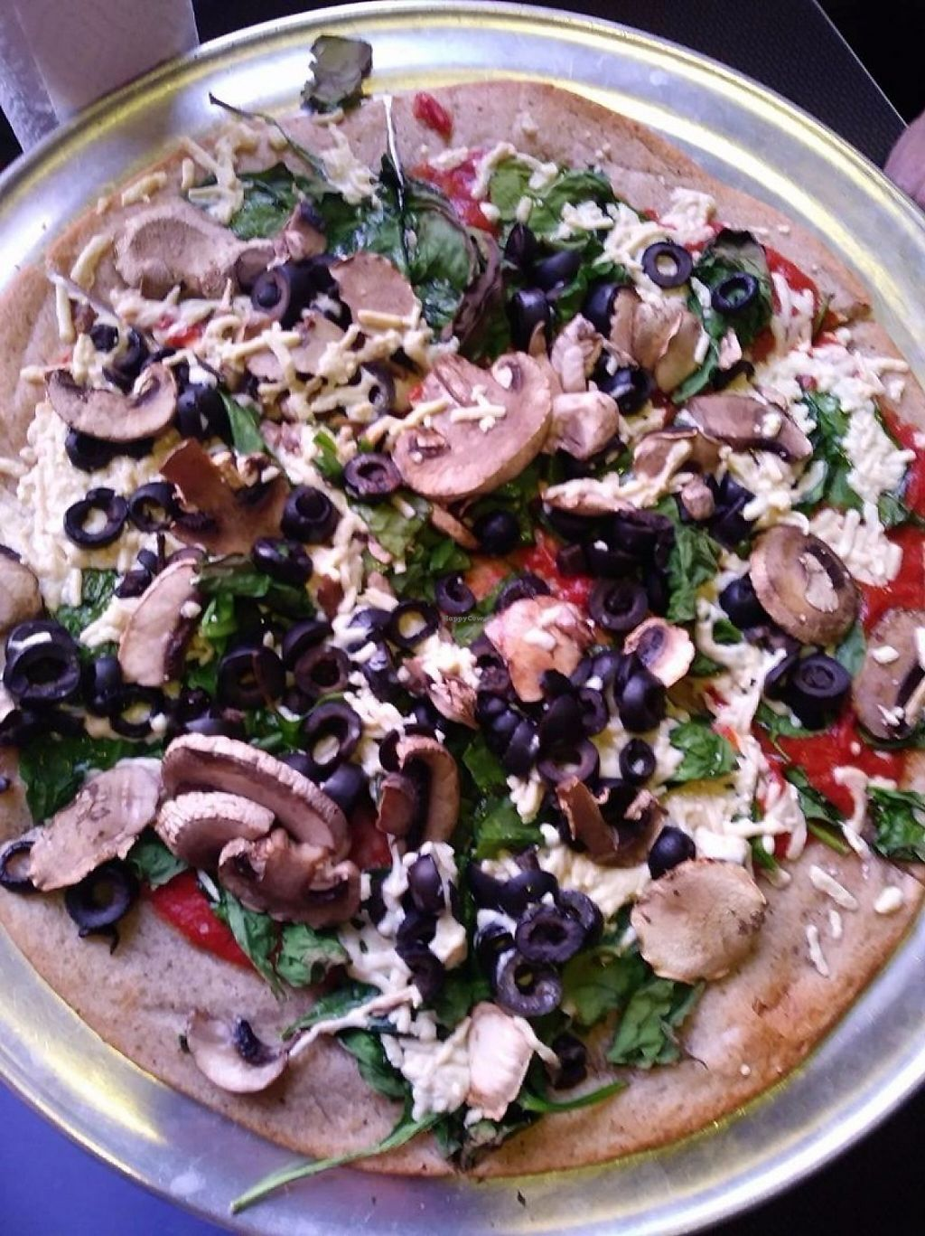 """Photo of Mellow Mushroom  by <a href=""""/members/profile/bjblunt71"""">bjblunt71</a> <br/>Gluten-free ~ Vegan ~ Mushrooms ~ Black Olives ~ Spinach ~ Daiya Mozzarella ~ Red Sauce <br/> June 6, 2017  - <a href='/contact/abuse/image/61470/266224'>Report</a>"""