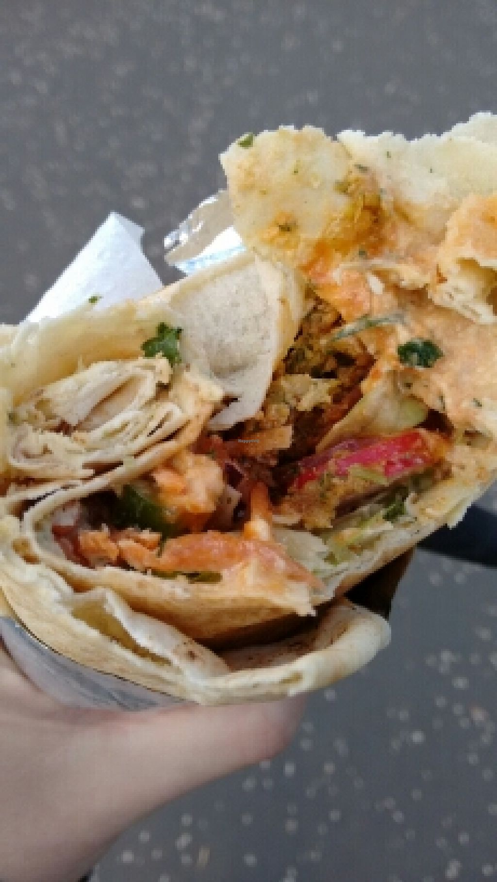 """Photo of Fired Up Food Hut  by <a href=""""/members/profile/craigmc"""">craigmc</a> <br/>great falafel wrap, and my thumb <br/> April 28, 2016  - <a href='/contact/abuse/image/61588/146569'>Report</a>"""