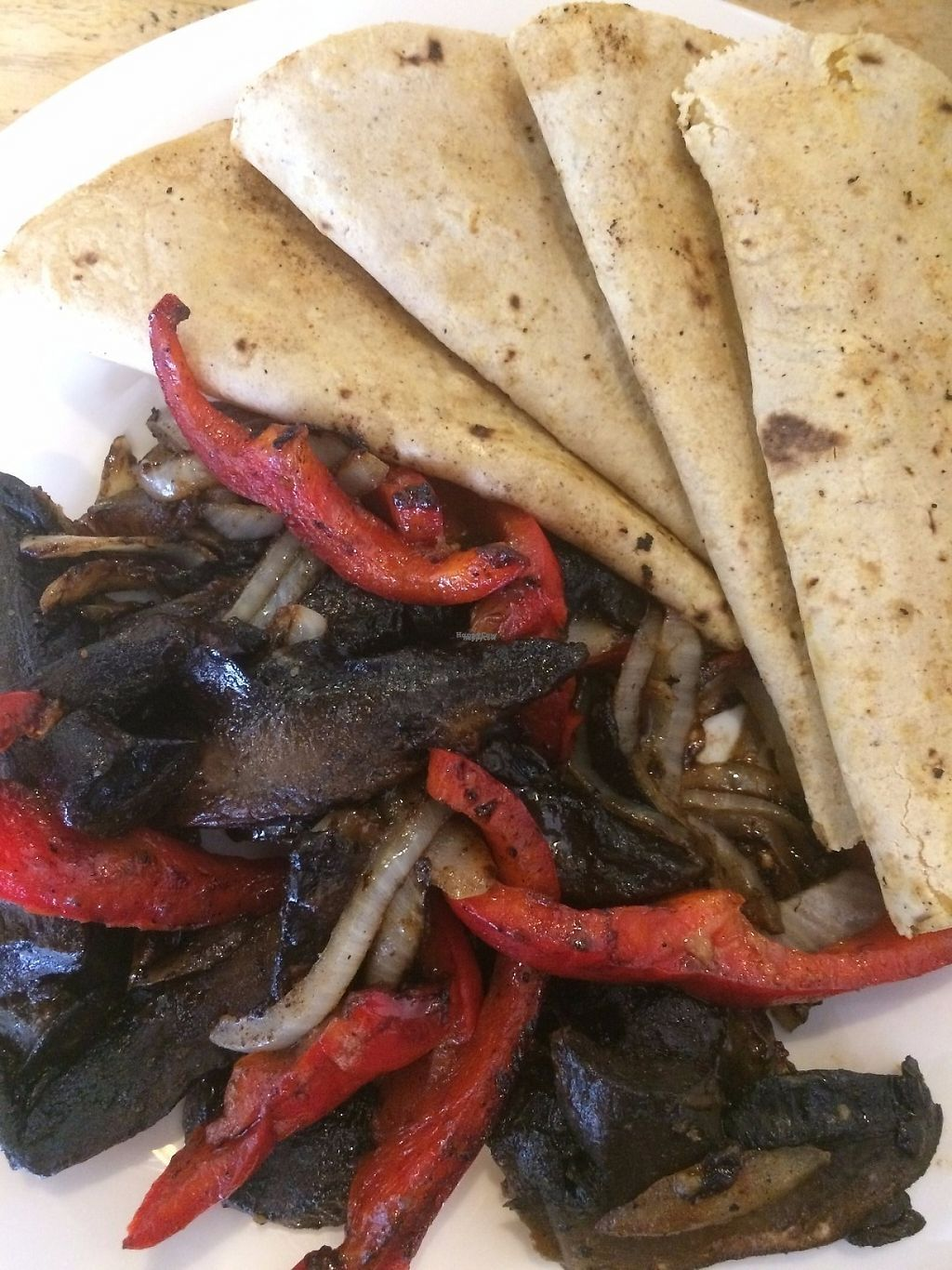 "Photo of Vegani  by <a href=""/members/profile/IOffie"">IOffie</a> <br/>fajita's con portobello, red pepper and  onion <br/> March 4, 2017  - <a href='/contact/abuse/image/61654/232542'>Report</a>"