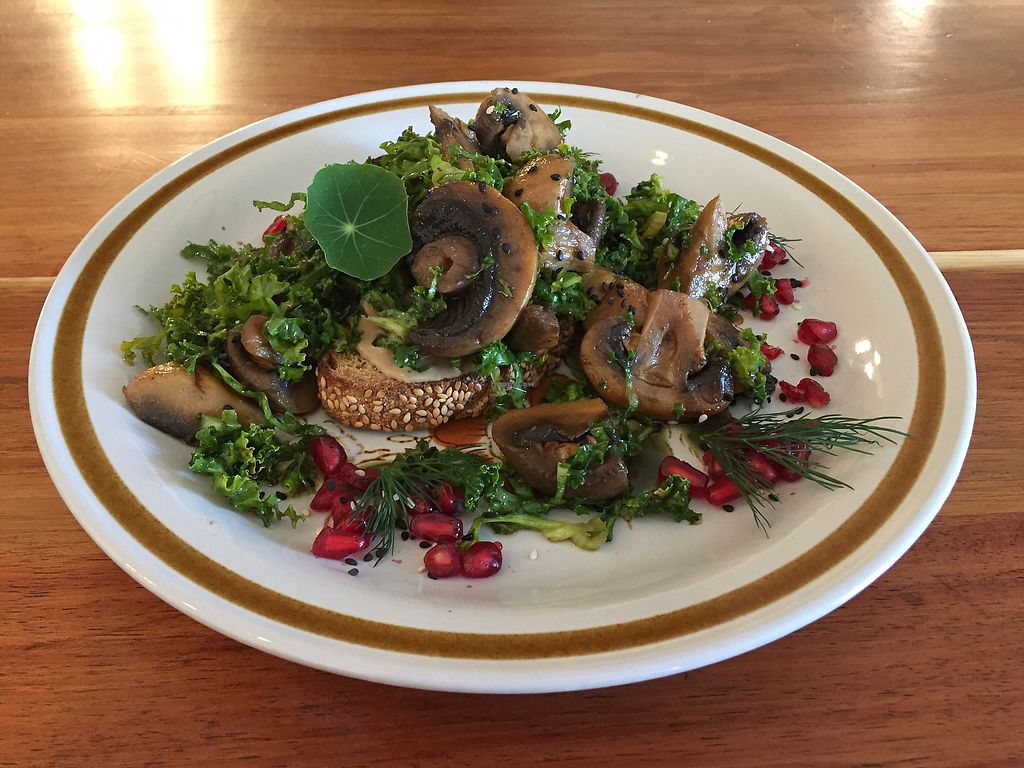 "Photo of Eka Wholefoods & Cafe  by <a href=""/members/profile/Wuji_Luiji"">Wuji_Luiji</a> <br/>Mushrooms with kale and pomegranate seeds on toast <br/> October 29, 2017  - <a href='/contact/abuse/image/61727/319718'>Report</a>"