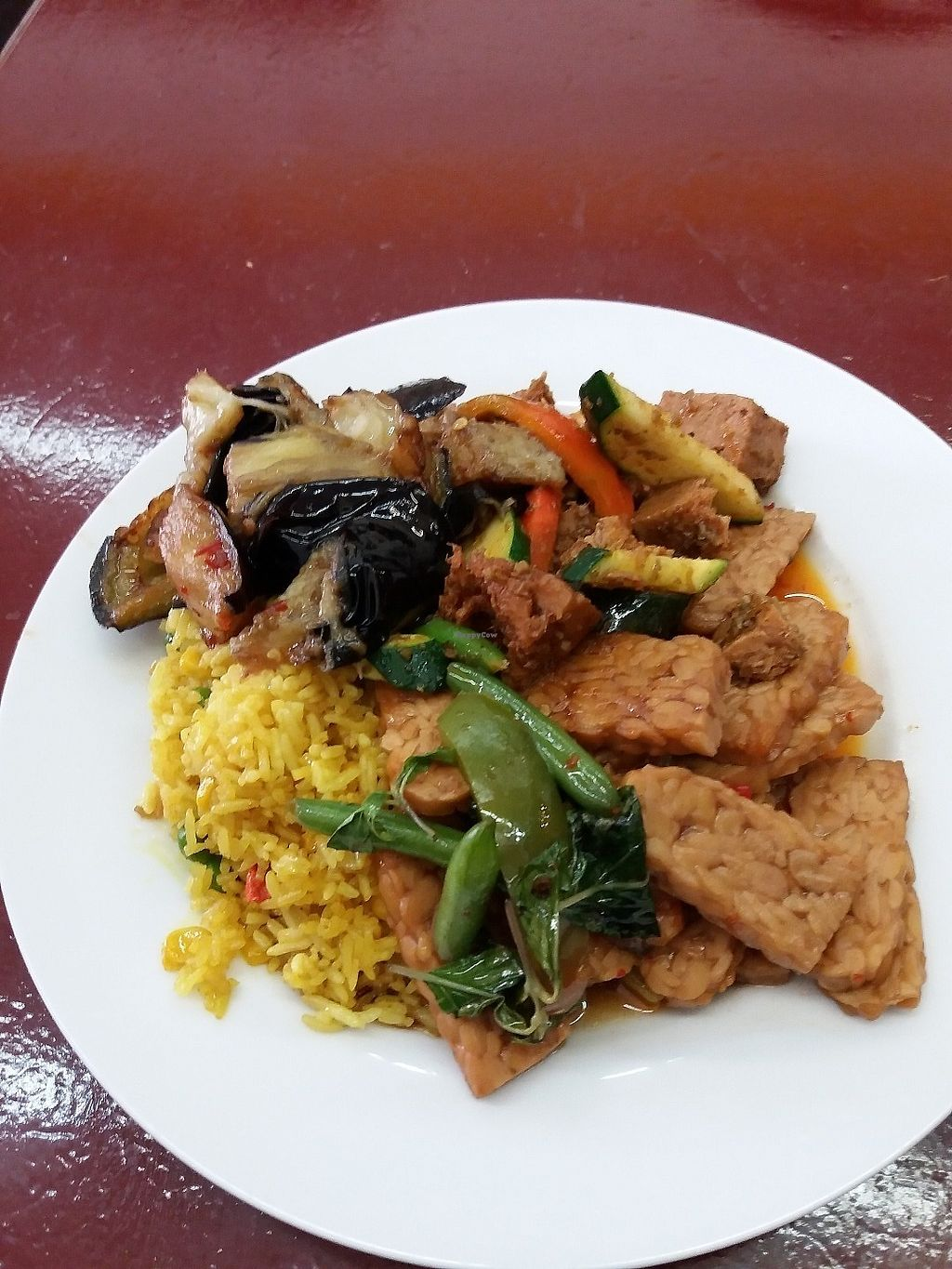 """Photo of Blossoming Lotus  by <a href=""""/members/profile/veganvirtues"""">veganvirtues</a> <br/>Tempeh, aubergine, veggies with fried rice $11:00 <br/> June 10, 2017  - <a href='/contact/abuse/image/6173/267574'>Report</a>"""
