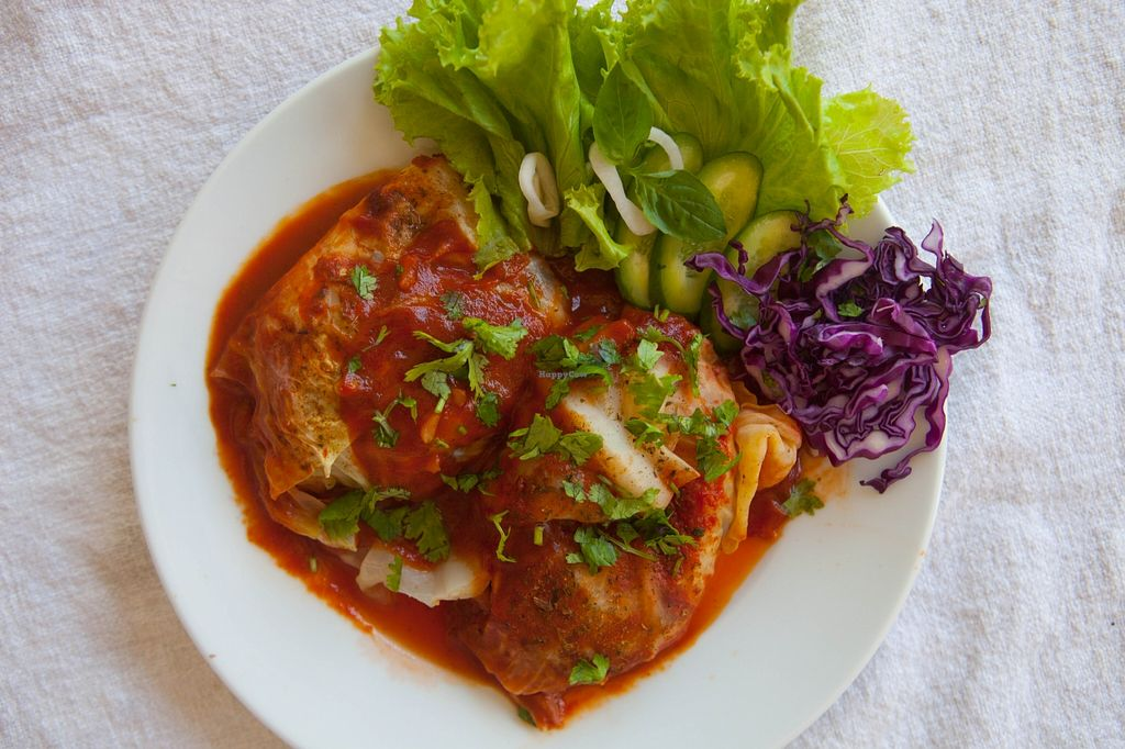 """Photo of CLOSED: Harmony  by <a href=""""/members/profile/Harmony%20Cafe"""">Harmony Cafe</a> <br/>vegan cabbage rolls, with tofu, ,  vegetables and rice, cooked in a tomato sauce <br/> October 28, 2015  - <a href='/contact/abuse/image/61956/122938'>Report</a>"""