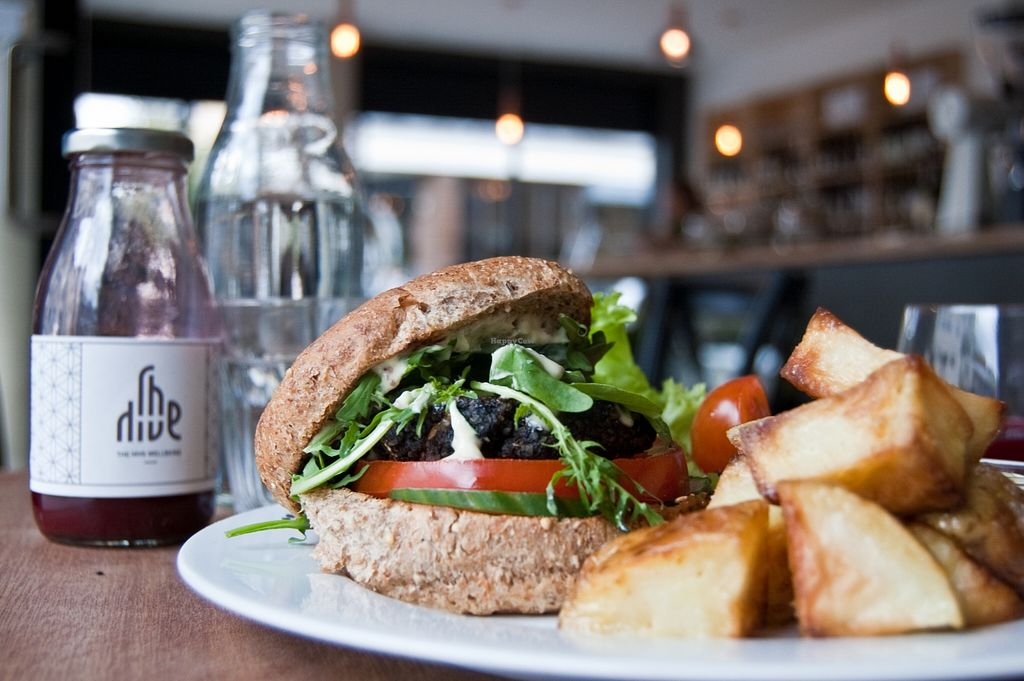 """Photo of The Hive of Vyner St  by <a href=""""/members/profile/r0chy"""">r0chy</a> <br/>This is the famous Hive Burger. It's surprisingly made with a mushroom and courgette patty! So delicious! And you cannot miss the roasted potatoes with vegan mayo!! <br/> January 5, 2016  - <a href='/contact/abuse/image/62027/131127'>Report</a>"""